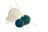 Two balls of wool with knitting needles and cap isolated on whit