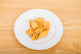 Corn Chips on White Plate and Wood Table