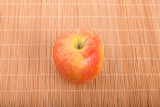 Single Gala Apple on Bamboo Placemat