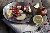 fruits composition with pomegranate lemon and pear