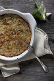 vegetables au gratin on casserole on wooden table