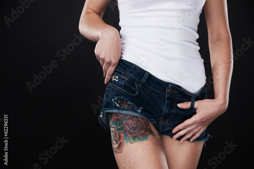 beautiful young girl with tattooed legs.