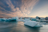 Icebergs in Jokulsarlon glacier lake at sunset