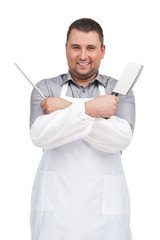 man wearing apron holding knife.