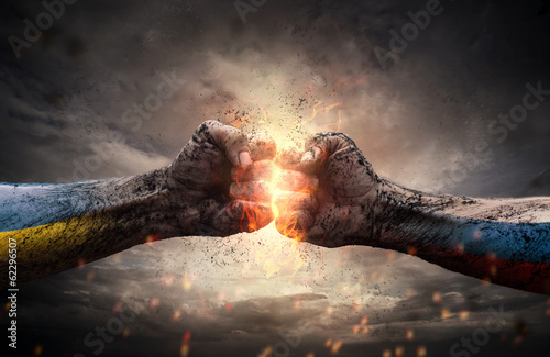 Conflict, close up of two fists hitting each other