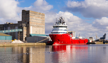 Large red cargo ship in Edinburgh docks.