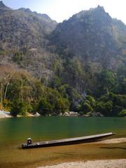 Boat by Nam Hin Bun river, Laos