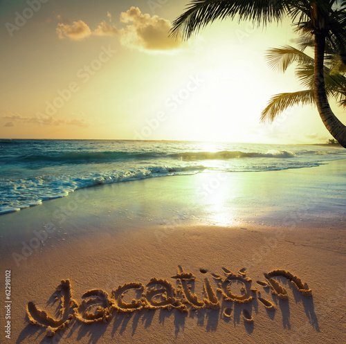 Art Summer vacation concept--vacation text on a sandy ocean beac