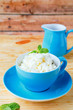 cottage cheese with cream in blue bowl