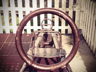 seesaw on playground with vintage effect