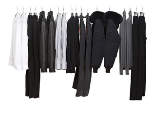Male clothes on cropped hangers on a white background