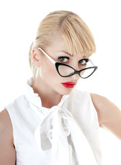 Portrait of seductive businesswoman wearing glasses on white bac