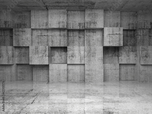Abstract empty concrete interior with cubes on the wall Photo by eugenesergeev