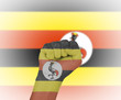 Fist wrapped in the flag of Uganda