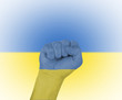 Fist wrapped in the flag of the Ukraine