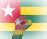 Fist wrapped in the flag of Togo