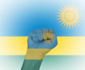Fist wrapped in the flag of Rwanda
