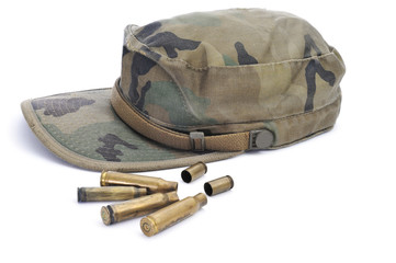 camouflage cap and empty bullets