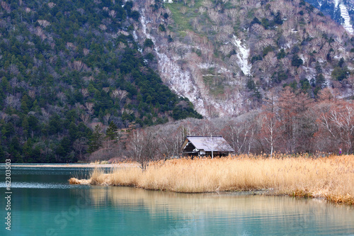 Beautiful lake with wooden house