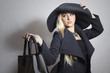 Beautiful Blond Woman in Black Hat with Handbag.Topcoat.Shopping