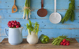 various vegetables and  retro kitchen utensils