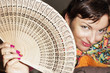 Joyful caucasian woman with a fan