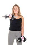 Cute young woman doing exercise with dumbbells.