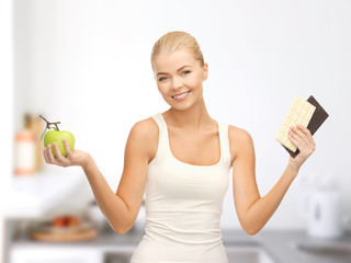sporty woman with apple and chocolate bars