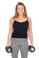 Cute young woman with dumbbells