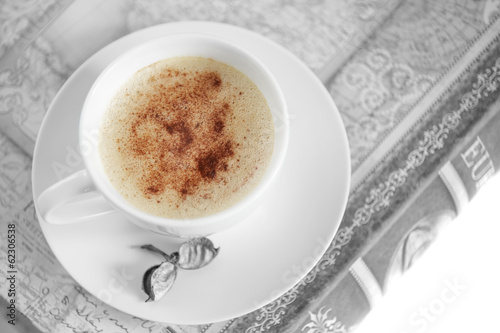 Cup of coffee, isolated against black and white