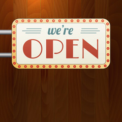 We are open vintage background sign on wood background