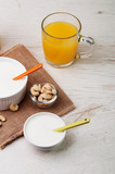 Yogurt with cashew nuts and juice