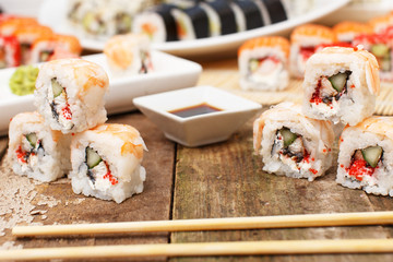 Several sushi with chopsticks on the table