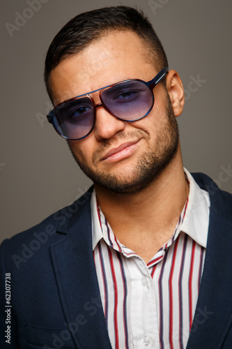Portrait of a stylish successful businessman in sunglasses