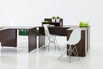 desks and chairs with reflection