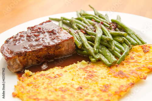 steak with potatao fritter and beans