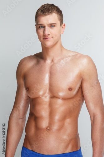 Young man's muscular torso in underwear