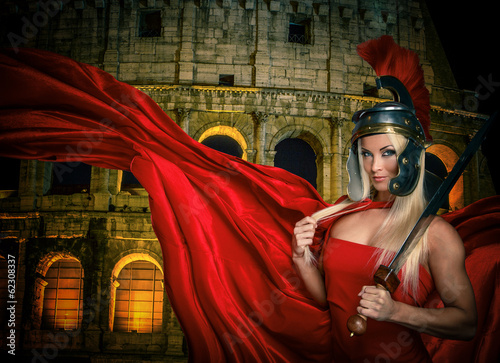 Fit blonde gladiatrix and Colossseum on the background