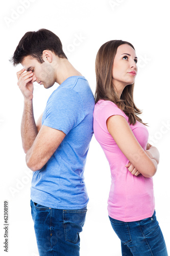 Unhappy couple standing back to back