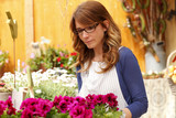 Beautiful woman working in flower shop