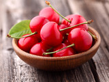 Sweet cherry in a wooden plate