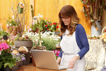 Florist working on laptop