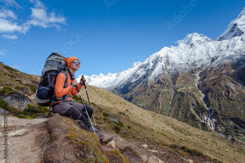 Hiker rests on trek in Himalayas, Nepal