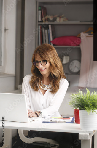 Modern businesswoman working on laptop