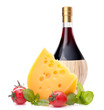 Red wine bottle, cheese and tomato still life