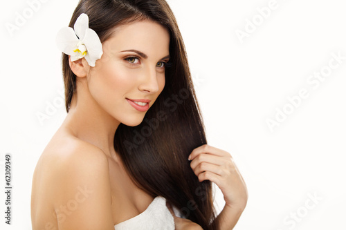 Brown Hair. Portrait of Beautiful Woman with Long Hair. High qua