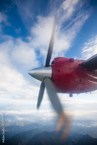 Propeller plane in air above Himalayas