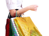 Young woman holding shopping bags.