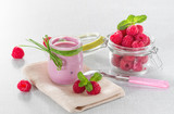 Raspberry yogurt with ripe raspberries