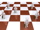 Businessmen as pawns on chessboard